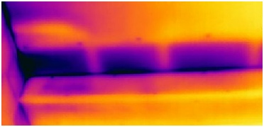 Thermal image of missing insulation shown by the darker areas