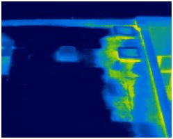 Thermal image of water leak on flat roof shown as lighter colours